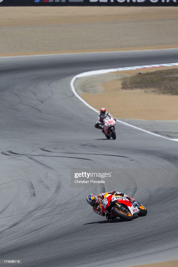 Dani Pedrosa of Spain and Repsol Honda Team accelerates out of the corner at the MotoGP race of Red Bull U.S. Grand Prix at Mazda Raceway Laguna Seca on July 19, 2013 in Monterey, California.