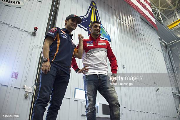 Dani Pedrosa of Spain and Repsol Honda Team and Andrea Iannone of Italy and Ducati Team smile during the preevent 'MotoGP Riders Visit The NASA...