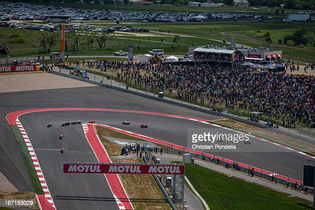 Dani Pedrosa of Spain and Repsol Honda Team and Marc Marquez of Spain and Repsol Honda Team rounds the first turn during the MotoGP Red Bull US Grand...