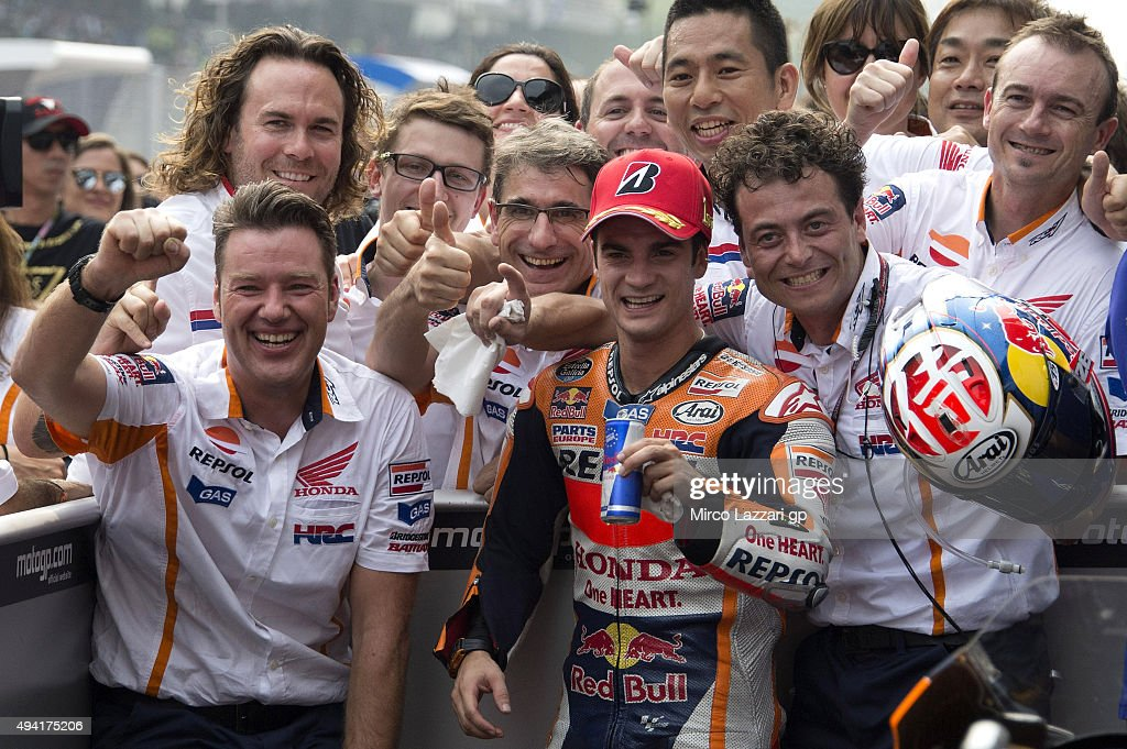 Dani Pedrosa of Spain and Repsol Honda Team celebrates the victory with team at the end of the MotoGP race during the MotoGP Of Malaysia at Sepang Circuit on October 25, 2015 in Kuala Lumpur, Malaysia.
