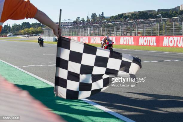 Dani Pedrosa of Spain and Repsol Honda Team cuts the finish lane and celebrates the victory at the end of the MotoGp race during the Comunitat...