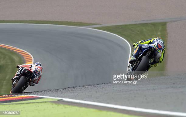 dani Pedrosa of Spain and Repsol Honda Team leads Valentino Rossi of Italy and Movistar Yamaha MotoGP during the MotoGP race during the MotoGp of...