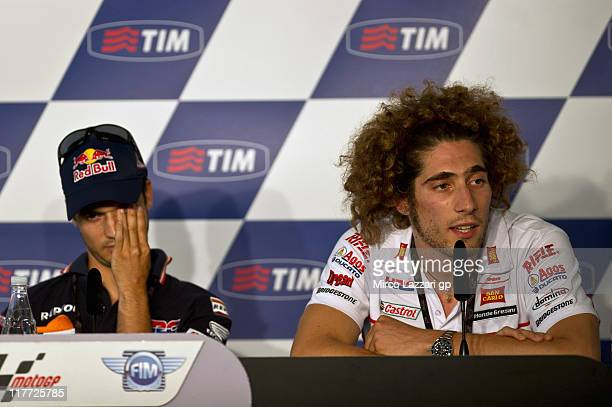 Dani Pedrosa of Spain and Repsol Honda Team looks on as Marco Simoncelli of Italy and San Carlo Honda Gresini speaks during the press conference...