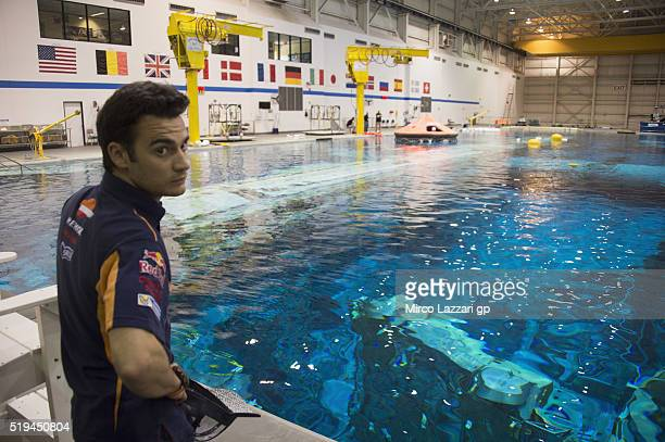 Dani Pedrosa of Spain and Repsol Honda Team looks on in the pool during the preevent 'MotoGP Riders Visit The NASA Johnson Space Center' at Lyndon B...