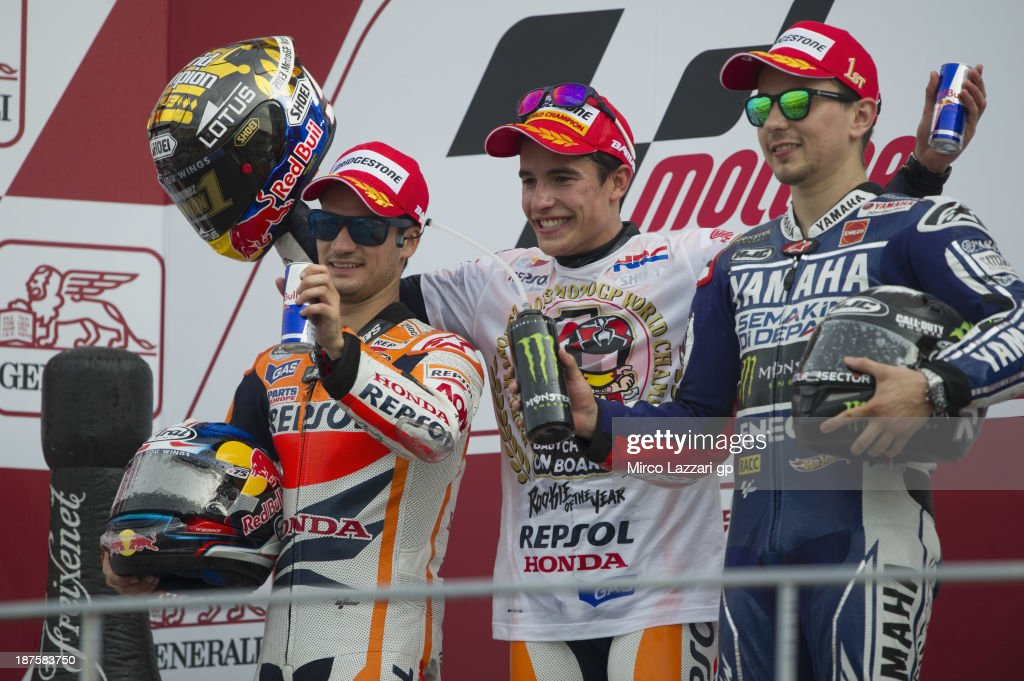Dani Pedrosa of Spain and Repsol Honda Team, <a gi-track='captionPersonalityLinkClicked' href=/galleries/search?phrase=Marc+Marquez&family=editorial&specificpeople=5409395 ng-click='$event.stopPropagation()'>Marc Marquez</a> (MotoGP World Champion) of Spain and Repsol Honda Team and <a gi-track='captionPersonalityLinkClicked' href=/galleries/search?phrase=Jorge+Lorenzo&family=editorial&specificpeople=543869 ng-click='$event.stopPropagation()'>Jorge Lorenzo</a> of Spain and Yamaha Factory Racing celebrate on the podium after the MotoGP race during the MotoGP of Valencia - Race at Ricardo Tormo Circuit on November 10, 2013 in Valencia, Spain.