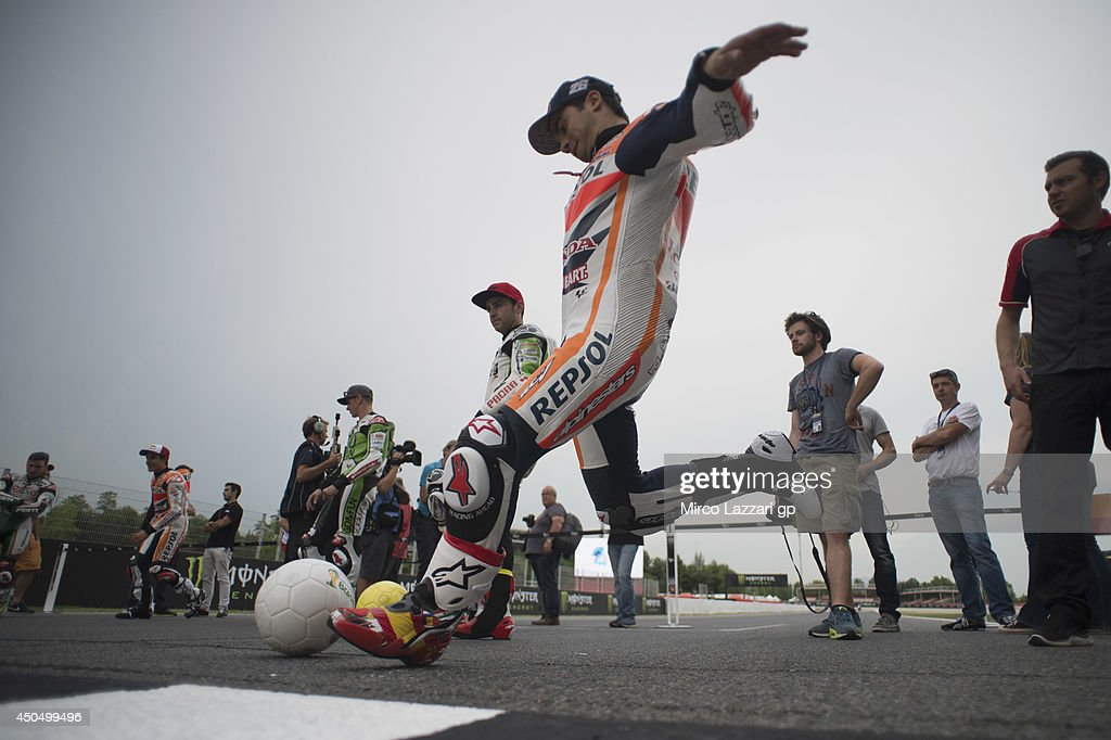 Dani Pedrosa of Spain and Repsol Honda Team plays during the event 'Launch of Alpinestars MotoGP World Cup Race Boot Design Series' on track during the MotoGp of Catalunya- Previews at Circuit de Catalunya on June 12, 2014 in Montmelo, Spain.