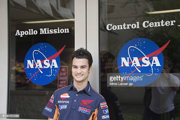 Dani Pedrosa of Spain and Repsol Honda Team poses in the entrance during the preevent 'MotoGP Riders Visit The NASA Johnson Space Center' at Lyndon B...