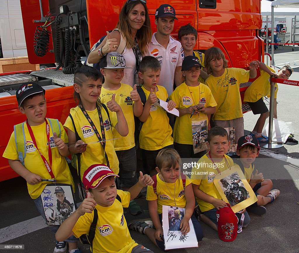Dani Pedrosa of Spain and Repsol Honda Team poses with young fans during the MotoGp Tests In Montmelo at Circuit de Catalunya on June 16, 2014 in Montmelo, Spain.