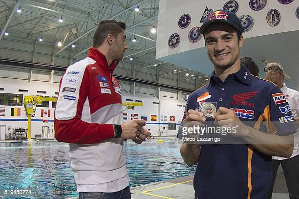 Dani Pedrosa of Spain and Repsol Honda Team shows the medal in the pool during the preevent 'MotoGP Riders Visit The NASA Johnson Space Center' at...