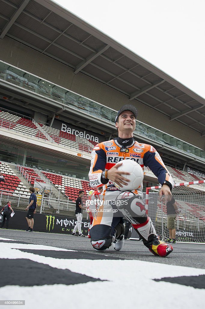 Dani Pedrosa of Spain and Repsol Honda Team smiles and shows the boot during the event 'Launch of Alpinestars MotoGP World Cup Race Boot Design Series' on track during the MotoGp of Catalunya- Previews at Circuit de Catalunya on June 12, 2014 in Montmelo, Spain.