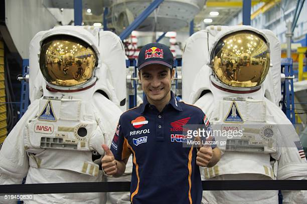 Dani Pedrosa of Spain and Repsol Honda Team smiles near spacesuits during the preevent 'MotoGP Riders Visit The NASA Johnson Space Center' at Lyndon...