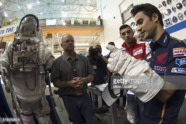 Dani Pedrosa of Spain and Repsol Honda Team tests a space glove in the pool during the preevent 'MotoGP Riders Visit The NASA Johnson Space Center'...