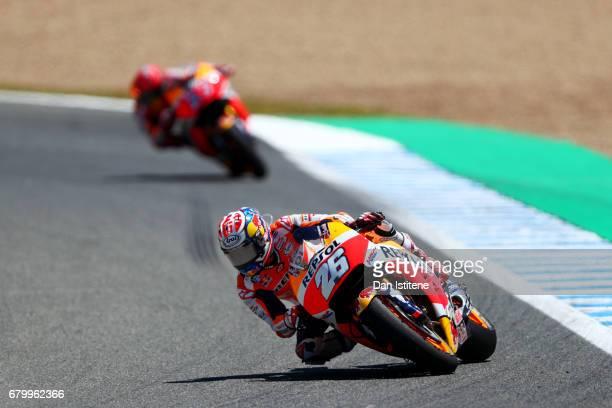 Dani Pedrosa of Spain and the Repsol Honda Team leads Marc Marquez of Spain and the Repsol Honda Team during the MotoGP of Spain at Circuito de Jerez...