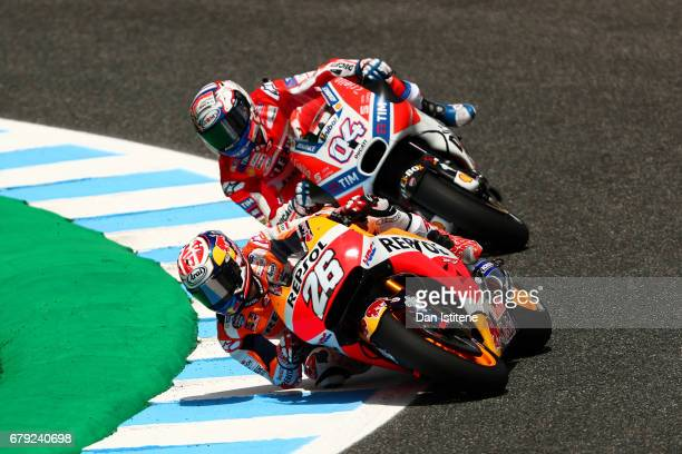 Dani Pedrosa of Spain and the Repsol Honda Team rides ahead of Andrea Dovizioso of Italy and the Ducati Team during free practice for the MotoGP of...