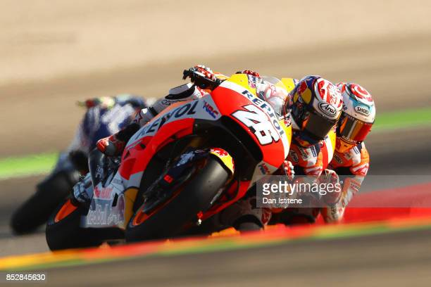 Dani Pedrosa of Spain and the Repsol Honda Team rides ahead of teammate Marc Marquez of Spain and the Repsol Honda Team during warmup before the...