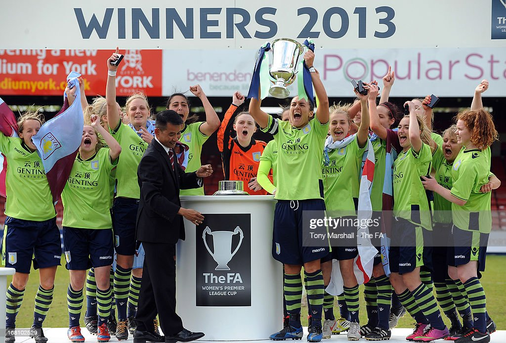 Dani Petrovic, aptain of Aston Villa Ladies lifts the trophy as her team-mates celebrate winning the FA Women's Premier League Cup Final between Aston Villa Ladies and Leeds United Ladies at Bootham Crescent Stadium on May 5, 2013 in York, England.