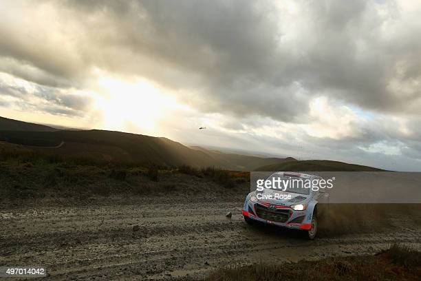 Dani Sordo and Marc Marti of Spain pilot the Hyundai Motorsport i20 WRC during the Myherin stage of the FIA World Rally Championship Great Britain on...