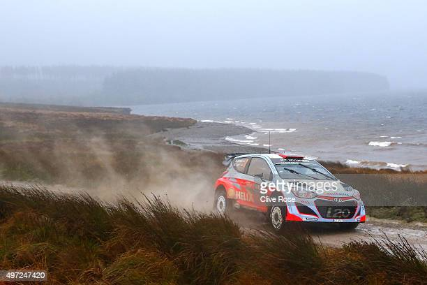 Dani Sordo and Marc Marti of Spain pilot the Hyundai Motorsport i20 WRC during the Brenig stage of the FIA World Rally Championship Great Britain on...