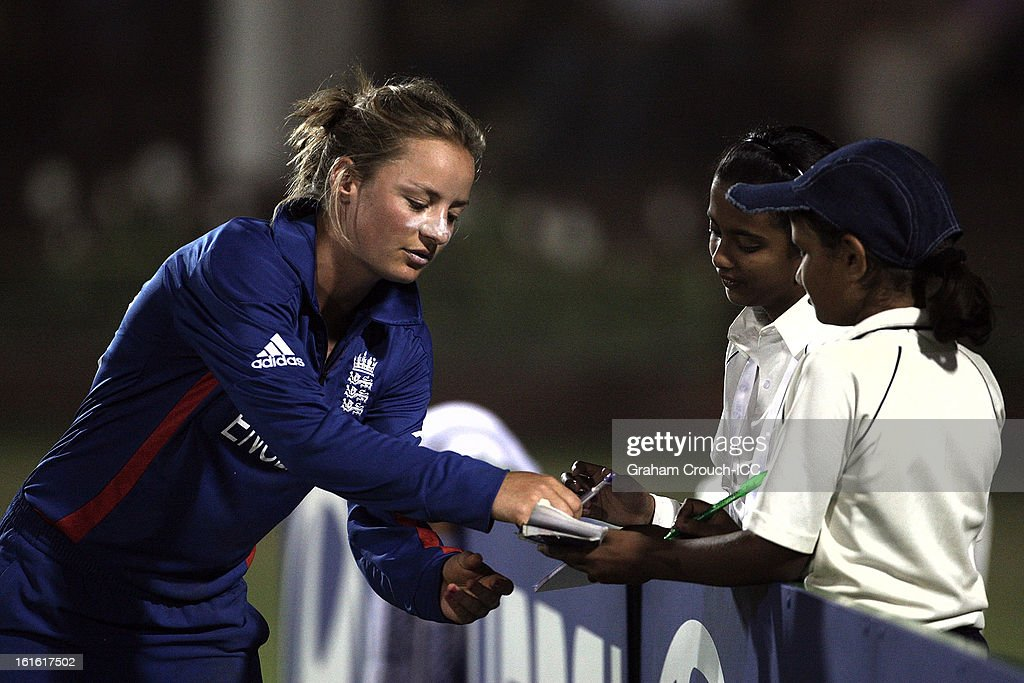 Dani Wyatt of England signs autographs during of the Super Sixes ICC Women's World Cup India 2013 match between New Zealand and England at the Cricket Club of India ground on February 13, 2013 in Mumbai, India.