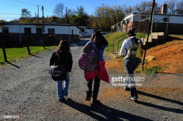 Dania Iris and Barbara have just left the school bus and head to their quarters at the migrant camp after school The migrant life is difficult for...