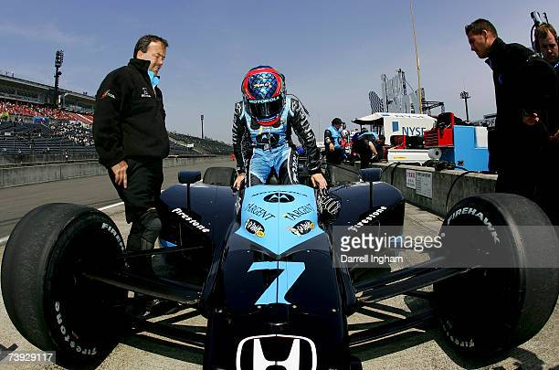Danica Patrick climbs aboard the Motorola Andretti Green Racing Dallara Honda during practice for the IRL Indycar Series Bridgestone Indy Japan 300...