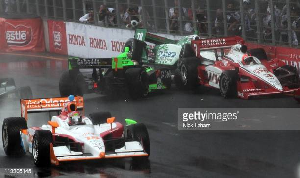 Danica Patrick driver of the Andretti Autosport Team GoDaddy Dallara Honda crashes into Simona De Silvestro of Switzerland driver of the Nuclear...