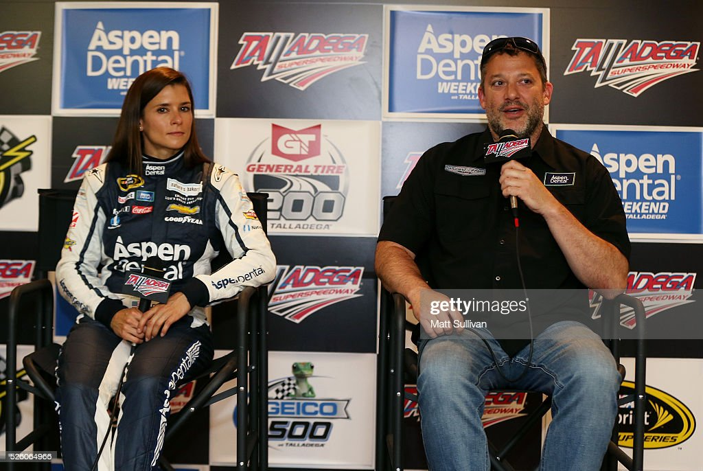 <a gi-track='captionPersonalityLinkClicked' href=/galleries/search?phrase=Danica+Patrick&family=editorial&specificpeople=183352 ng-click='$event.stopPropagation()'>Danica Patrick</a>, driver of the #10 Aspen Dental Chevrolet, and <a gi-track='captionPersonalityLinkClicked' href=/galleries/search?phrase=Tony+Stewart+-+Race+Car+Driver&family=editorial&specificpeople=201686 ng-click='$event.stopPropagation()'>Tony Stewart</a>, driver of the #14 Bass Pro Shops Chevrolet, speak to the media prior to practice for the NASCAR Sprint Cup Series GEICO 500 at Talladega Superspeedway on April 29, 2016 in Talladega, Alabama.