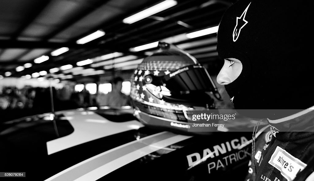 <a gi-track='captionPersonalityLinkClicked' href=/galleries/search?phrase=Danica+Patrick&family=editorial&specificpeople=183352 ng-click='$event.stopPropagation()'>Danica Patrick</a>, driver of the #10 Aspen Dental Chevrolet, stands in the garage area during practice for the NASCAR Sprint Cup Series GEICO 500 at Talladega Superspeedway on April 29, 2016 in Talladega, Alabama.