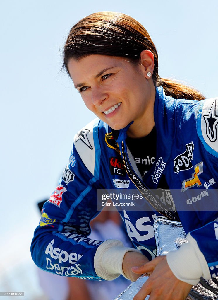 <a gi-track='captionPersonalityLinkClicked' href=/galleries/search?phrase=Danica+Patrick&family=editorial&specificpeople=183352 ng-click='$event.stopPropagation()'>Danica Patrick</a>, driver of the #10 Aspen Dental Chevrolet, stands on the grid before the NASCAR Sprint Cup Series Kobalt 400 at Las Vegas Motor Speedway on March 9, 2014 in Las Vegas, Nevada.