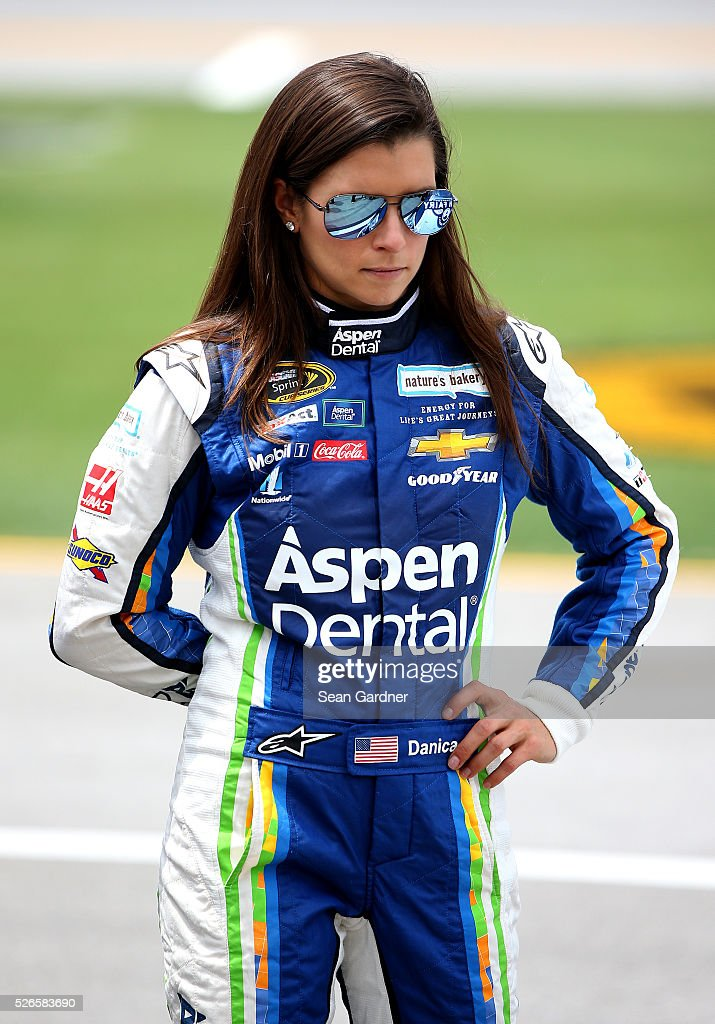 Danica Patrick, driver of the #10 Aspen Dental Chevrolet, stands on the grid during qualifying for the NASCAR Sprint Cup Series GEICO 500 at Talladega Superspeedway on April 30, 2016 in Talladega, Alabama.