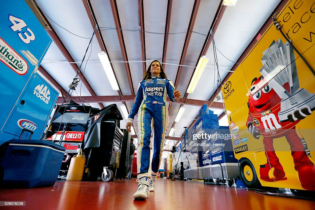 <a gi-track='captionPersonalityLinkClicked' href=/galleries/search?phrase=Danica+Patrick&family=editorial&specificpeople=183352 ng-click='$event.stopPropagation()'>Danica Patrick</a>, driver of the #10 Aspen Dental Chevrolet, walks through the garage area during practice for the NASCAR Sprint Cup Series GEICO 500 at Talladega Superspeedway on April 29, 2016 in Talladega, Alabama.