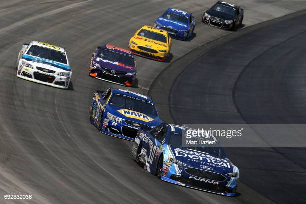 Danica Patrick driver of the Aspen Dental Ford leads a pack of cars during the Monster Energy NASCAR Cup Series AAA 400 Drive for Autism at Dover...