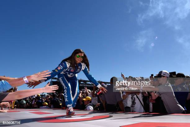 Danica Patrick driver of the Aspen Dental Ford participates in the driver intros before the 59th Annual DAYTONA 500 at Daytona International Speedway...
