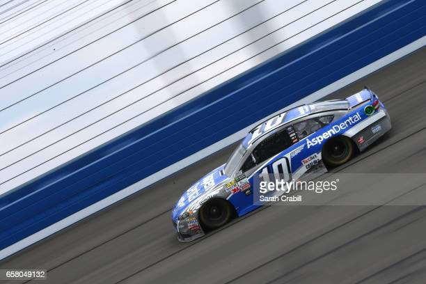 Danica Patrick driver of the Aspen Dental Ford races during the Monster Energy NASCAR Cup Series Auto Club 400 at Auto Club Speedway on March 26 2017...