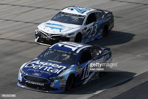 Danica Patrick driver of the Aspen Dental Ford races Gray Gaulding driver of the Addiction Campuses Toyota during the Monster Energy NASCAR Cup...