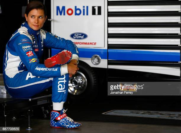 Danica Patrick driver of the Aspen Dental Ford sits in the garage during practice for the Monster Energy NASCAR Cup Series Auto Club 400 at Auto Club...