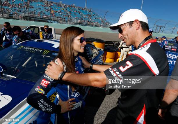 Danica Patrick driver of the Aspen Dental Ford speaks to race car driver Helio Castroneves during prerace ceremonies for the Monster Energy NASCAR...