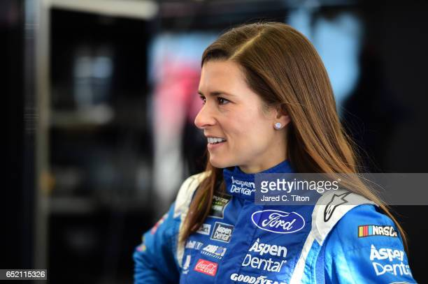 Danica Patrick driver of the Aspen Dental Ford stands in the garage area during practice for the Monster Energy NASCAR Cup Series Kobalt 400 at Las...