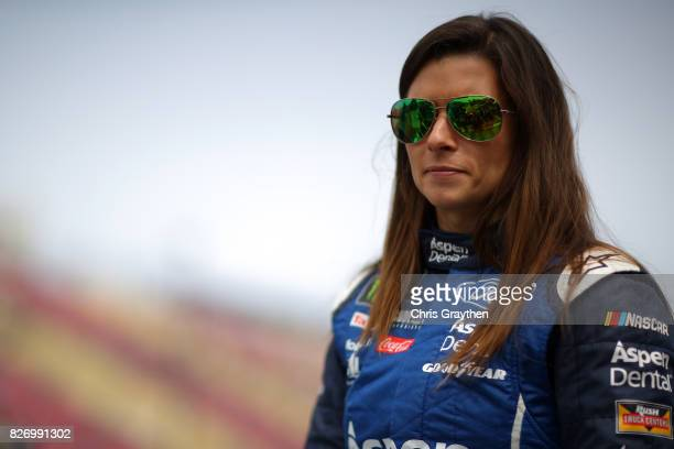 Danica Patrick driver of the Aspen Dental Ford stands on the grid during qualifying for the Monster Energy NASCAR Cup Series I Love NY 355 at The...