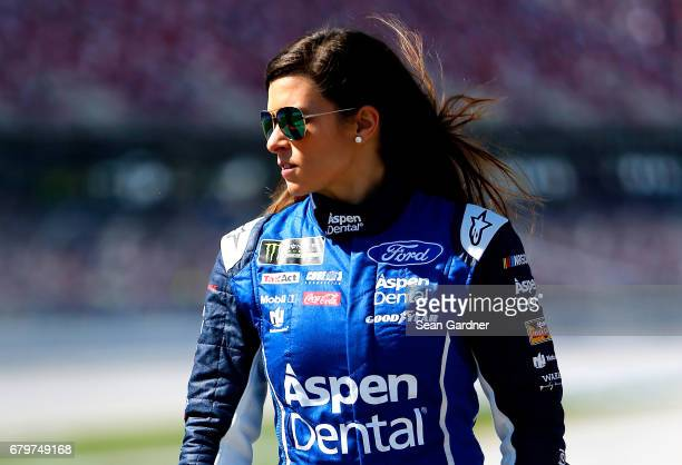 Danica Patrick driver of the Aspen Dental Ford walks on the grid during qualifying for the Monster Energy NASCAR Cup Series GEICO 500 at Talladega...