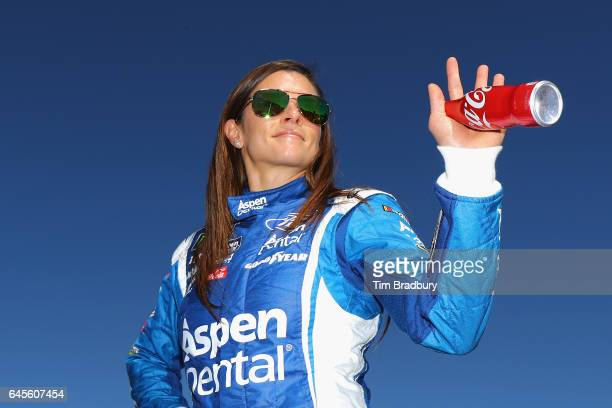 Danica Patrick driver of the Aspen Dental Ford waves prior to the 59th Annual DAYTONA 500 at Daytona International Speedway on February 26 2017 in...