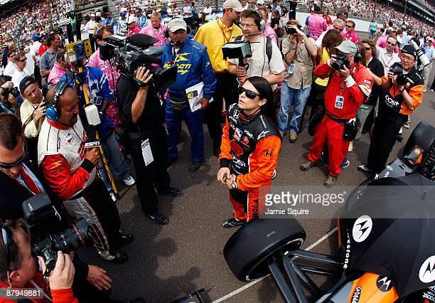 Danica Patrick driver of the Boost Mobile/Motorola Andretti Green Racing Dallara Honda prepares to enter her car prior to the start of the IRL...