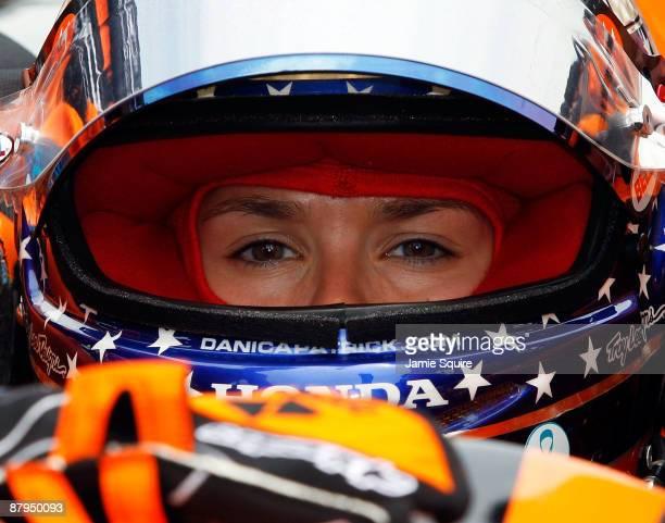 Danica Patrick driver of the Boost Mobile/Motorola Andretti Green Racing Dallara Honda enters her car prior to the start of the IRL IndyCar Series...