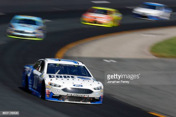 Danica Patrick driver of the Code 3 Associates Ford leads a pack of cars during the Monster Energy NASCAR Cup Series ISM Connect 300 at New Hampshire...