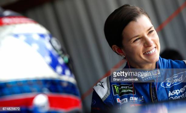 Danica Patrick driver of the Code 3 Associates Ford stands in the garage area during practice for the Monster Energy NASCAR Cup Series Toyota Owners...