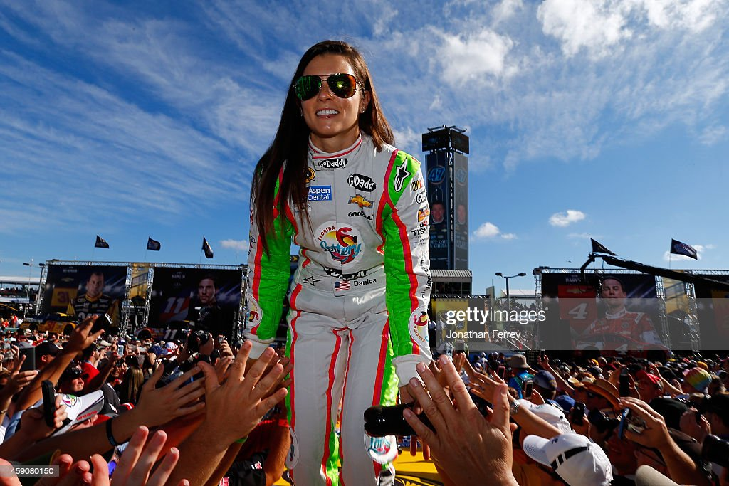 <a gi-track='captionPersonalityLinkClicked' href=/galleries/search?phrase=Danica+Patrick&family=editorial&specificpeople=183352 ng-click='$event.stopPropagation()'>Danica Patrick</a>, driver of the #10 Florida Lottery/GoDaddy Chevrolet, is introduced during pre-race ceremonies for the NASCAR Sprint Cup Series Ford EcoBoost 400 at Homestead-Miami Speedway on November 16, 2014 in Homestead, Florida.