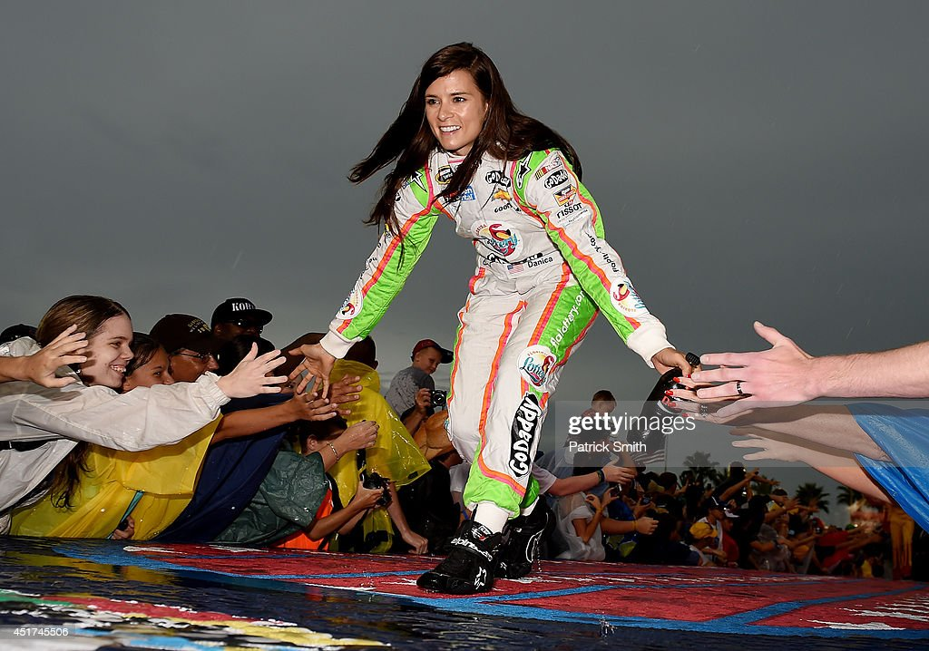<a gi-track='captionPersonalityLinkClicked' href=/galleries/search?phrase=Danica+Patrick&family=editorial&specificpeople=183352 ng-click='$event.stopPropagation()'>Danica Patrick</a>, driver of the #10 Florida Lottery/GoDaddy Chevrolet, is introduced prior to the NASCAR Sprint Cup Series Coke Zero 400 at Daytona International Speedway on July 5, 2014 in Daytona Beach, Florida.
