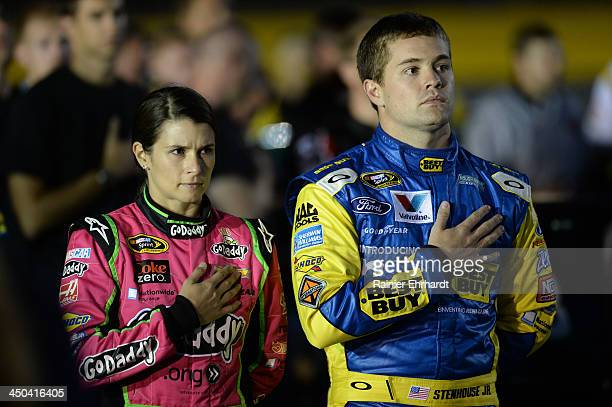 Danica Patrick driver of the GoDaddy Breast Cancer Awareness Chevrolet and Ricky Stenhouse Jr driver of the My Best Buy Ford during qualifying for...