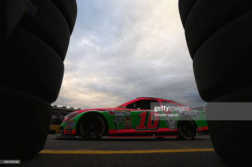Danica Patrick, driver of the #10 GoDaddy Breast Cancer Awareness Chevrolet, drives through the garage area during practice for the NASCAR Sprint Cup Series Bank of America 500 at Charlotte Motor Speedway on October 11, 2013 in Concord, North Carolina.