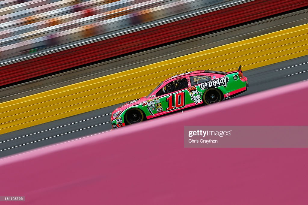 <a gi-track='captionPersonalityLinkClicked' href=/galleries/search?phrase=Danica+Patrick&family=editorial&specificpeople=183352 ng-click='$event.stopPropagation()'>Danica Patrick</a>, driver of the #10 GoDaddy Breast Cancer Awareness Chevrolet, practices for the NASCAR Sprint Cup Series Bank of America 500 at Charlotte Motor Speedway on October 11, 2013 in Concord, North Carolina.